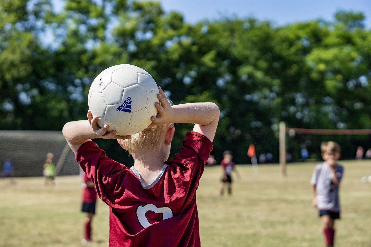 Boy throws in a soccer ball from the sideline. For highly active kids, or those that may not enjoy a diet with a broad range of foods, supplementation can be useful to supercharge their healing.