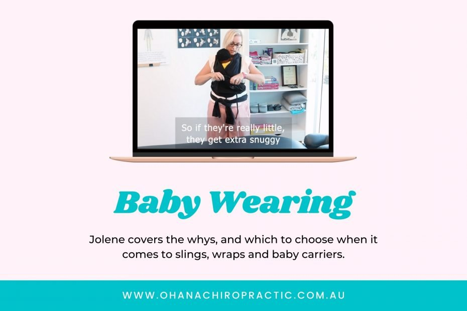 Image is a laptop with screen shot of baby wearing